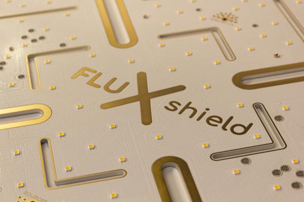 FLUXshield Logo w kolorze złotym